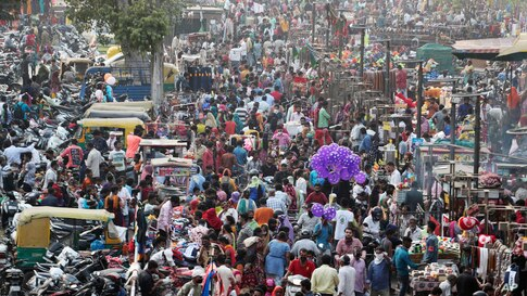 Indians crowd a market for shopping ahead of Hindu festival Diwali in Ahmedabad, India.