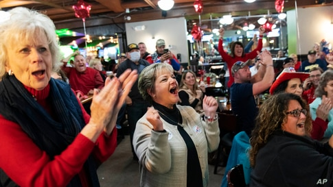 Supporters of President Donald Trump cheer while watching election results at a watch party in Shelby Township, Michigan, Nov. 3, 2020.