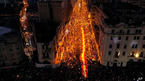 People who are refusing to recognize Peru's new government gather to protest in Lima, Nov. 14, 2020.