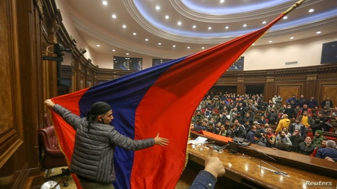 People storm the parliament in Yerevan, Armenia, after Prime Minister Nikol Pashinyan said he had signed an agreement with leaders of Russia and Azerbaijan to end the war.