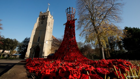 A poppy display is seen as part of remembrance commemorations in the Parish Church of St Peter & St Paul in Chatteris, Britain.