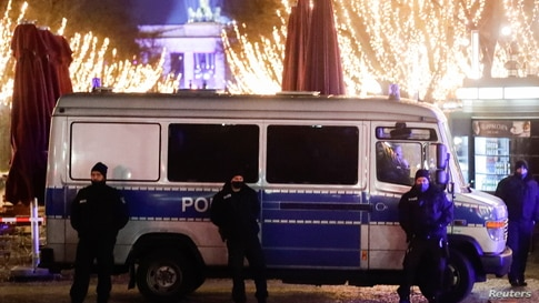 Police secure the area near the Brandenburg Gate on New Year's Eve, amid coronavirus disease (COVID-19) restrictions in Berlin,…