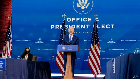President-elect Joe Biden, accompanied by Vice President-elect Kamala Harris, speaks at a news conference to introduce their nominees and appointees to economic policy posts at The Queen theater, Dec. 1, 2020, in Wilmington, Del.