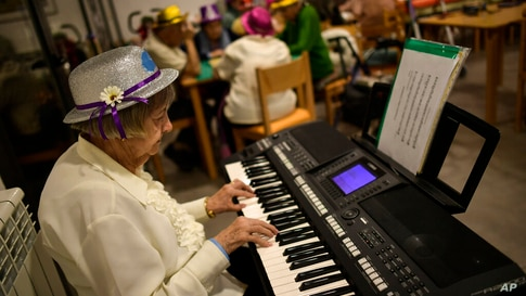 Conchita, 90 years old, a resident of the San Jeronimo nursing home, plays a piano during New Year's Eve celebrations in…