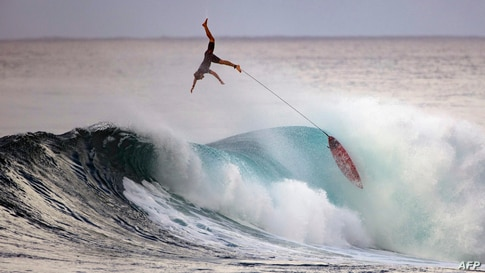 Surfer Nathan Florence wipes out during practice at Sunset Beach in Pupukea, Oahu, Hawaii, Dec. 29, 2020.