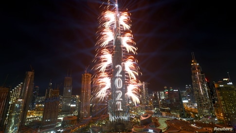 Fireworks explode from the Burj Khalifa, the tallest building in the world, during New Year's Eve celebrations in Dubai, United Arab Emirates, Dec. 31, 2020.