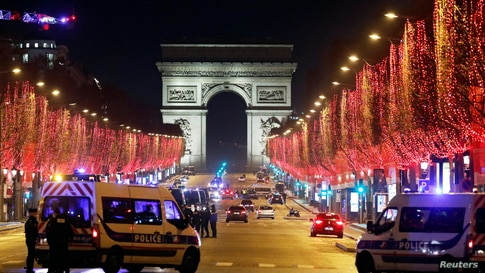 French police patrol on the Champs Elysees avenue in Paris after celebrations and gatherings have been banned due to COVID-19 restrictions in France, Dec. 31, 2020.