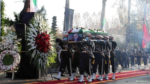 Members of Iranian forces carry the coffin of slain nuclear scientist Mohsen Fakhrizadeh during a funeral ceremony in Tehran, Nov. 30, 2020.