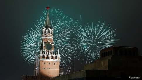 Fireworks explode behind the Kremlin's Spasskaya Tower during New Year's Day celebrations in Moscow, Russia, Jan. 1, 2021.
