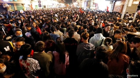 People gather on a street during New Year's Eve celebrations in Hanoi, Vietnam, Jan. 1, 2021.