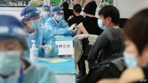 People receive vaccines against the Covid-19 coronavirus at a temporary vaccination centre in Beijing on January 8, 2021. …