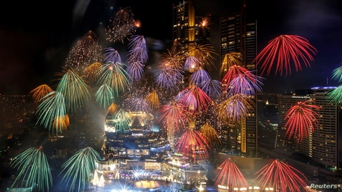 Fireworks explode over Chao Phraya River during the New Year celebrations amid the spread of the coronavirus disease in Bangkok, Thailand.