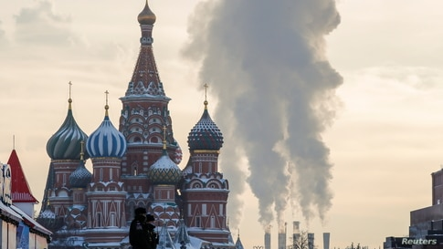 Police officers walk across Red Square on a cold day in Moscow, Russia, Jan. 18, 2021.