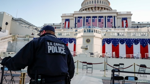 A U.S. Capitol police officer stands on the West Front of the Capitol before Joe Biden's presidential inauguration.