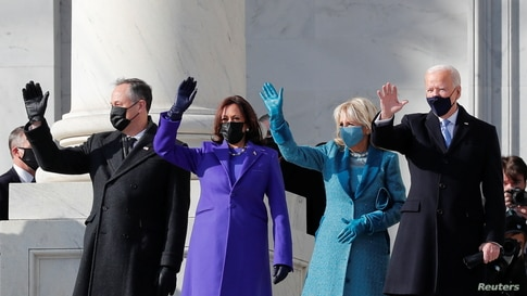 President-elect Joe Biden, his wife Jill Biden, Vice President-elect Kamala Harris and her husband Doug Emhoff salute.