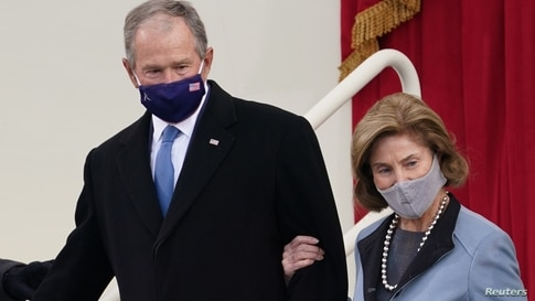 Former U.S. President George W. Bush and his wife Laura Bush arrive for the inauguration of Joe Biden as the 46th President.