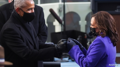 Vice President-elect Kamala Harris greets former U.S. President Barack Obama ahead of the inauguration of Joe Biden.