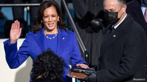 Kamala Harris is sworn in as Vice President as her spouse Doug Emhoff holds a bible during the 59th Presidential Inauguration.
