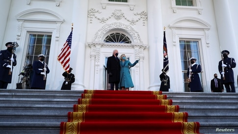 U.S. President Joe Biden and first lady Jill Biden stand at the North Portico of the White House, in Washington.