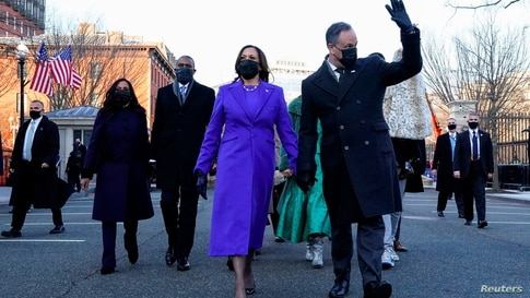 U.S. Vice President Kamala Harris and her husband Douglas Emhoff walk during the Inauguration Day parade.