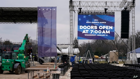 Workers build the stage on the ellipse near the White House on Tuesday, Jan. 5, 2021, ahead of expected rallies on Jan. 6.