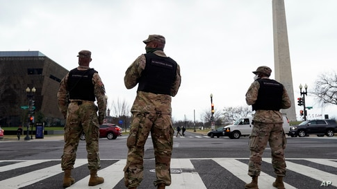 Members of the DC National Guard provide traffic control at an intersection near a rally at Freedom Plaza, Jan. 5, 2021.