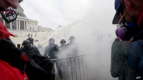 Trump supporters try to break through a police barrier, Jan. 6, 2021, at the Capitol in Washington.