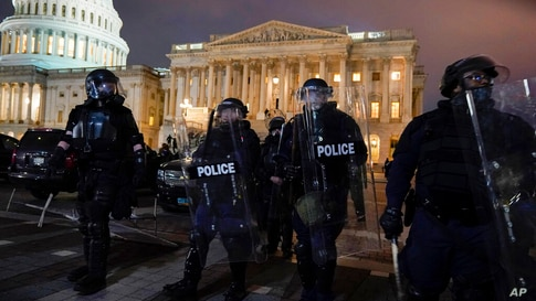 Authorities remove protesters from the U.S. Capitol, Wednesday, Jan. 6, 2021, in Washington. (AP Photo/Jacquelyn Martin)