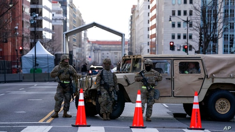 Members of the National Guard at a check point in downtown, ahead of President-elect Joe Biden's inauguration ceremony, Monday,…