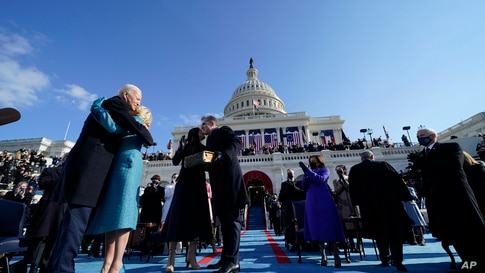 President Joe Biden hugs first lady Jill Biden, as his son Hunter Biden and daughter Ashley Biden look on after he was sworn-in.