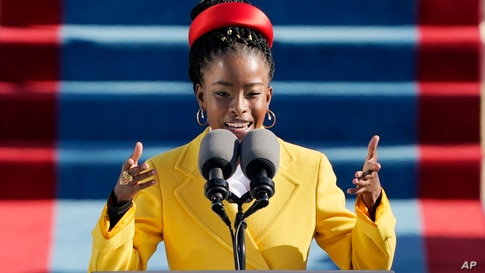 American poet Amanda Gorman reads a poem during the 59th Presidential Inauguration at the U.S. Capitol in Washington, Jan. 20, 2021.
