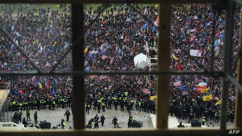 Police hold back supporters of U.S. President Donald Trump as they gather outside the Capitol's Rotunda, Jan. 6, 2021, in Washington, D.C.