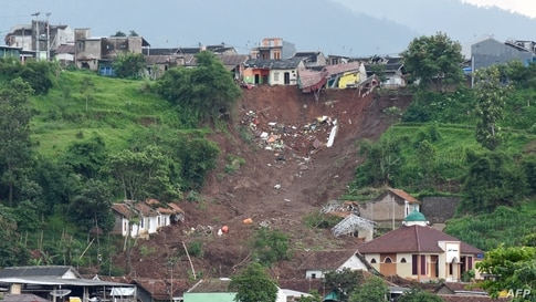 This general view shows the side of a hill which collapsed and swept away homes in Sumedang, West Java province after landslides killed at least 11 people and left scores more missing.