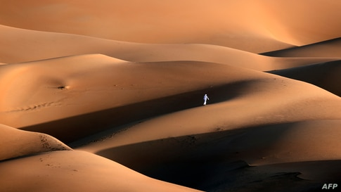 An Emirati youth plays in the sand dunes in the Liwa desert, some 250 kilometres west of the Gulf Emirate of Abu Dhabi, Jan. 9, 2021.