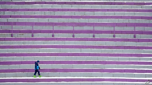 A lone spectator stands during competition jumps at the the third stage of the 69th Four Hills ski jumping tournament in Innsbruck, Austria.