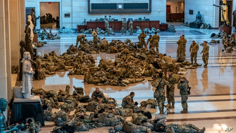 Hundreds of National Guard troops are seen inside the Capitol Visitor's Center at the Capitol in Washington, D.C.
