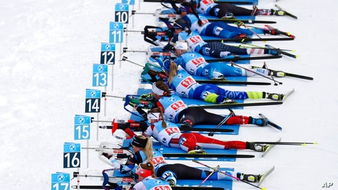 Athletes shoot during the mixed relay race at the Biathlon World Cup in Oberhof, Germany.