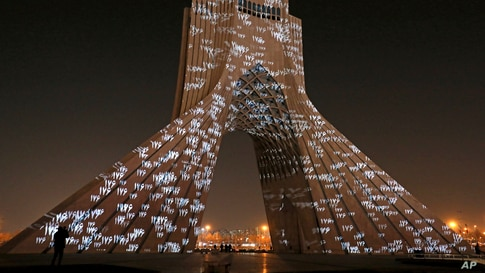 The video mapping is projected on Tehran's iconic Azadi(freedom) tower to commemorate 176 victims of the Ukrainian flight during a municipal memorial marking the first anniversary of the plane crash, in Tehran, Iran.