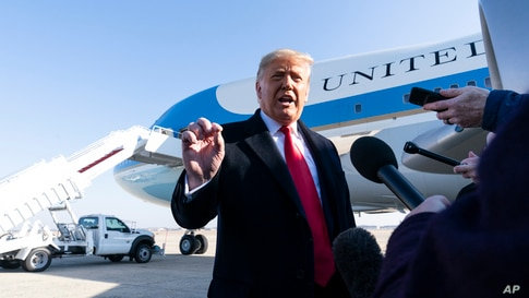 President Donald Trump speaks with reporters before boarding Air Force One Jan. 12, 2021, at Andrews Air Force Base, Maryland, to travel to Texas.