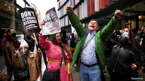 People celebrate outside the Old Bailey, the Central Criminal Court, in London, after a British judge ruled that WikiLeaks founder Julian Assange should not be extradited to the United States.