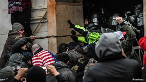 """Supporters of U.S. President Donald Trump clash with police at the west entrance of the Capitol during a """"Stop the Steal"""" protest outside of the Capitol building in Washington D.C., Jan. 6, 2021."""