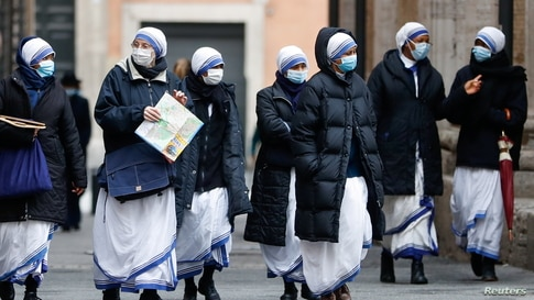 Nuns walk as the region enters the 'yellow zone' after the government relaxed some of the COVID-19 curbs on weekdays following a strict lockdown over the holidays, in Rome, Italy.