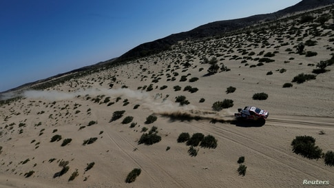 Toyota Gazoo Racing's Nasser Al-Attiyah and Co-Driver Matthieu Baumel compete during Stage 1 of the Dakar Rally between Jeddah and Bisha in Saudi Arabia.