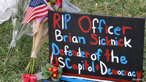 Items are left to memorialize slain U.S. Capitol Police officer Brian Sicknick, who died from injuries sustained during the attack at the Capitol on Jan. 6, 2021, in Washington, D.C.