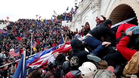 Pro-Trump protesters storm into the U.S. Capitol during a rally to contest the certification of the 2020 U.S. presidential election results by the U.S. Congress, in Washington, January 6, 2021.