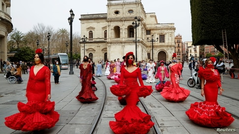 Women wearing flamenco dresses take part in a protest against the crisis in the flamenco fashion sector generated by the…