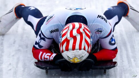 Katie Uhlaender, of the United States, reacts at the end of her run during the women's skeleton race at the Bobsleigh and…