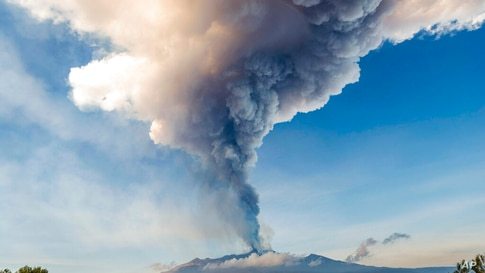 Smoke billows from the Mt Etna volcano as seen from Giarre, Sicily, Friday, Feb. 19, 2021. Europe's most active volcano remains…