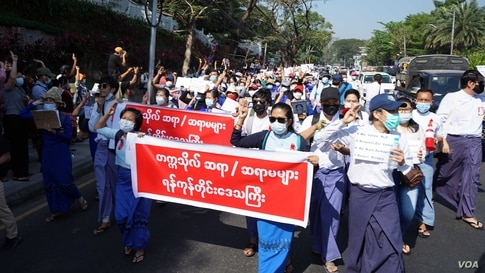 Teachers from universities march in Yangon, Mayanmar, Feb. 9, 2021, to protest against the military coup.