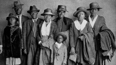 """Scott and Violet Arthur arrive with their family at Chicago's Polk Street Depot on Aug. 30, 1920, two months after their two sons were lynched in Paris, Texas. The picture has become an iconic symbol of the Great Migration. (Chicago History Museum)"